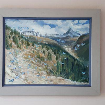 Blue Butterflies in zermatt - frame with blue trim and solid grey surround.